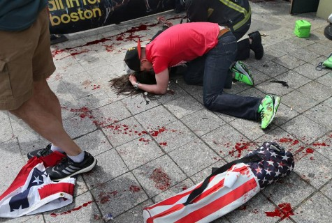 Man comforting victim of Boston Marathon bombing